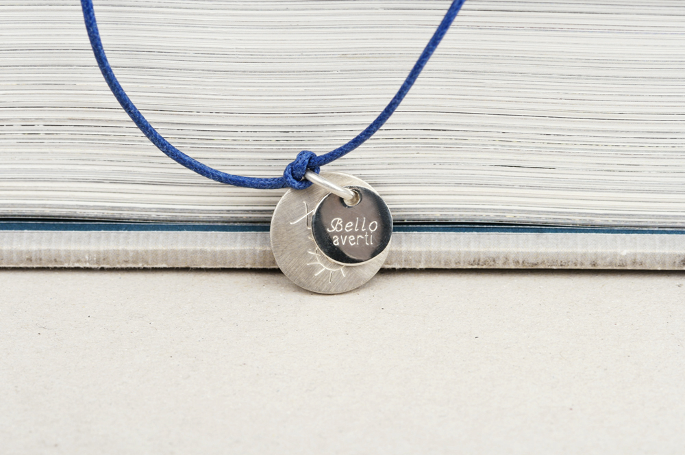 Puces. Round Silver Pendant