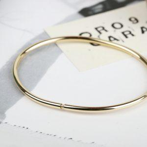 Bracciali bangle in oro giallo apribili. Maschio Gioielli Milano
