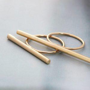 Gold bar rings (6)