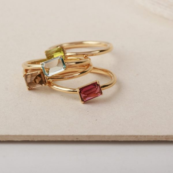 Set of gold rings with emerald-cut stone (13)