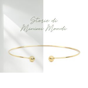 Yellow gold open bangle bracelet with two gold beads _ maschio gioielli milano