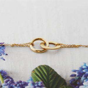 Bracciale in oro giallo con catenina e infinito asimmetrico _ maschio gioielli milano