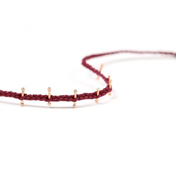 Braccialetto sottile intrecciato in cordino bordeaux con piccoli bastoncini in argento rosa _ maschio gioielli milano