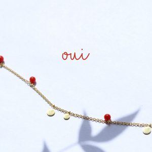 Tiny gold necklace with pendants and red coral stones _ maschio gioielli milano