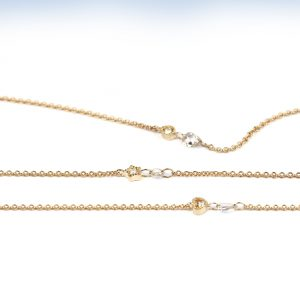 Minimalist thin gold chain bracelet with little shaped element and loose white faceted diamond _ maschio gioielli milano