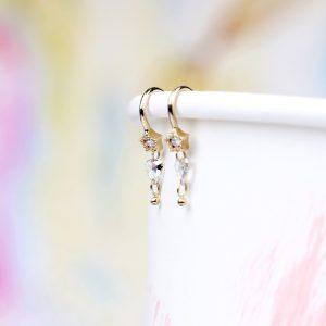 Orecchini in oro con stella e diamante sfaccettato irregolare _ maschio gioielli milano