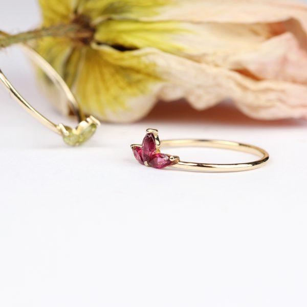 Subtle minimalist lotus flower ring made of gold and navette-cut fuchsia tourmaline _ maschio gioielli milano