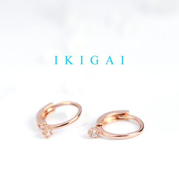 Piccoli orecchini a cerchio in argento rosa con zirconi _ maschio gioielli milano
