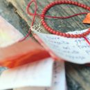 Elastic bracelet with red coral beads and gold lotus pendant _ maschio gioielli milano (5)