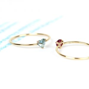 Stacking set of gold thin rings with heart-cut stone _maschio gioielli milano