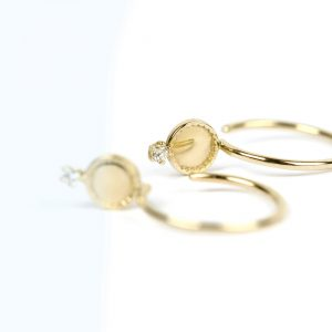 Open hoop earrings in yellow gold and brilliant-cut diamond _ maschio gioielli milano